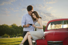The couple in love looking to the mobile phone Stock Photography