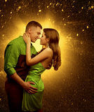 Couple in Love, Lover Man Embrace Woman, Two Lovers Kiss. Green dress Stock Image