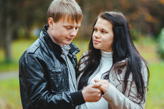 A couple in love. Loving married couple walking in the autumn park Royalty Free Stock Image