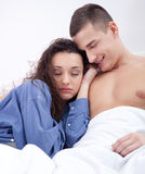 Couple in love lying in bed Stock Photography