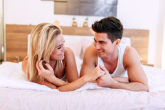 Couple in love lying on bed royalty free stock images