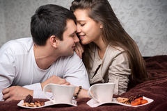 Couple in love. Couple, while lying down on the bed during the breakfast room Kissy Face Royalty Free Stock Photos