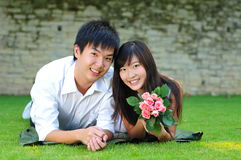 Couple In Love Lying On The Grass Royalty Free Stock Photo