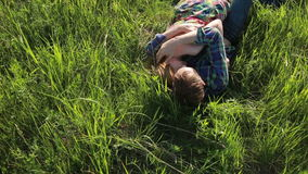 Couple in love lying on the grass stock video