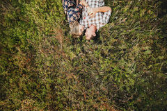 Couple in love lying on grass. Holding hands Stock Photo