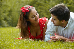 Couple in love lying on the grass in the park Royalty Free Stock Photo
