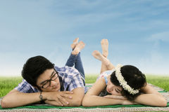 Couple in love lying on the meadow Royalty Free Stock Images