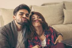 Couple making funny faces while taking photos royalty free stock image