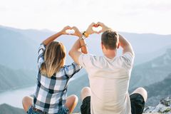 Couple in love meditating in nature royalty free stock photos