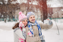 Couple in love making selfie on winter picnic at park. stock images
