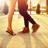 Couple in love. Male and female legs closeup Stock Images