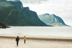 Couple in love Man running to Woman at sea Norway beach Travel happy emotions Lifestyle. Concept romantic vacations Royalty Free Stock Photos
