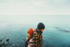 Couple in love Man and Woman back to back standing above sea. Traveling together happy emotions Lifestyle concept. Young family romantic vacations Royalty Free Stock Photography