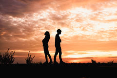 Couple in love ,man and women are quarrel in natu. Silhouette of  couple in love ,man and women are quarrel in nature  in sunset time Royalty Free Stock Photos