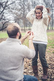 Couple in love marriage proposal. At the park winter Stock Photography