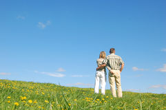 Couple in love on meadow Stock Photos