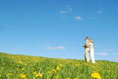 Couple in love on meadow Royalty Free Stock Image