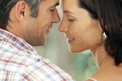 Couple in love - moment of intimacy between middle aged man and woman. Couple in love - moment of intimacy between middle aged men and women - close up on stock photo