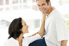 Couple in love - moment of intimacy between middle aged man and woman. Couple in love - moment of intimacy between middle aged men and women - men looking at stock image