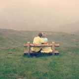 Couple in love on a mountain top Royalty Free Stock Photo