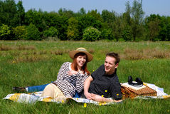 Couple love nature. Young handsome couple on picnic, nature setting Stock Photography
