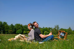 Couple love nature. Young handsome couple on picnic, nature setting Stock Photos