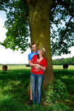 Couple love nature. Young handsome couple, man and woman in love, nature setting royalty free stock images