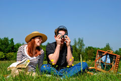 Couple love nature. Young handsome couple on picnic, nature setting Royalty Free Stock Photography