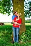 Couple love nature. Young handsome couple, man and woman in love, nature setting stock photography