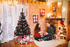 Couple in love near the Christmas tree Stock Photo