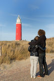 Couple in love near red lighthouse Stock Photography