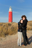 Couple in love near red lighthouse Royalty Free Stock Photography