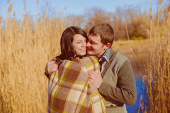 Couple in love near the river in the spring Stock Photos