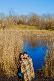Couple in love near the river in the spring Royalty Free Stock Photos