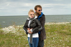 Couple in love near the sea autumn Royalty Free Stock Images
