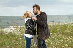 Couple in love near the sea autumn Royalty Free Stock Photo