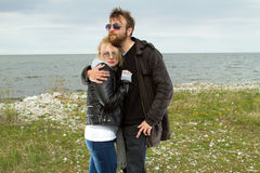 Couple in love near the sea autumn Stock Images