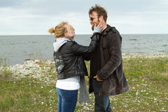 Couple in love near the sea autumn. Royalty Free Stock Photo