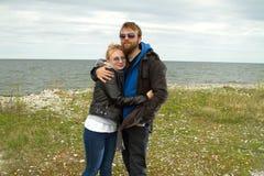Couple in love near the sea autumn Stock Photography
