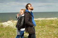 Couple in love near the sea autumn. Royalty Free Stock Photo