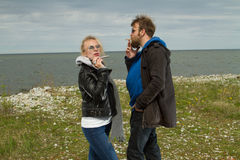Couple in love near the sea autumn. Royalty Free Stock Images