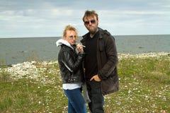 Couple in love near the sea autumn. Stock Photo
