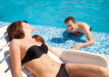 Couple in love near swimming pool Stock Images