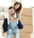 Portrait of a couple in love in a new empty apartment. Couple in love in a new apartment. Concept of real estate Royalty Free Stock Photo