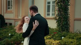 Couple in love newlyweds.Bride in wedding dress puts her hands on groom's chest stock video footage