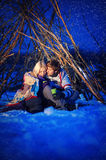Couple in love at night, drink tea, it's snowing Royalty Free Stock Image