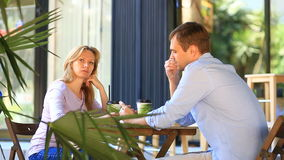Couple in love in an outdoor cafe. Man and beautiful woman on a date. stock footage