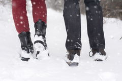 Couple in love outdoors walking on snow Stock Photography