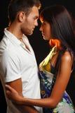 Couple in love over dark background Stock Photos