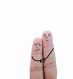 Couple in love painted on fingers.  Stock Image